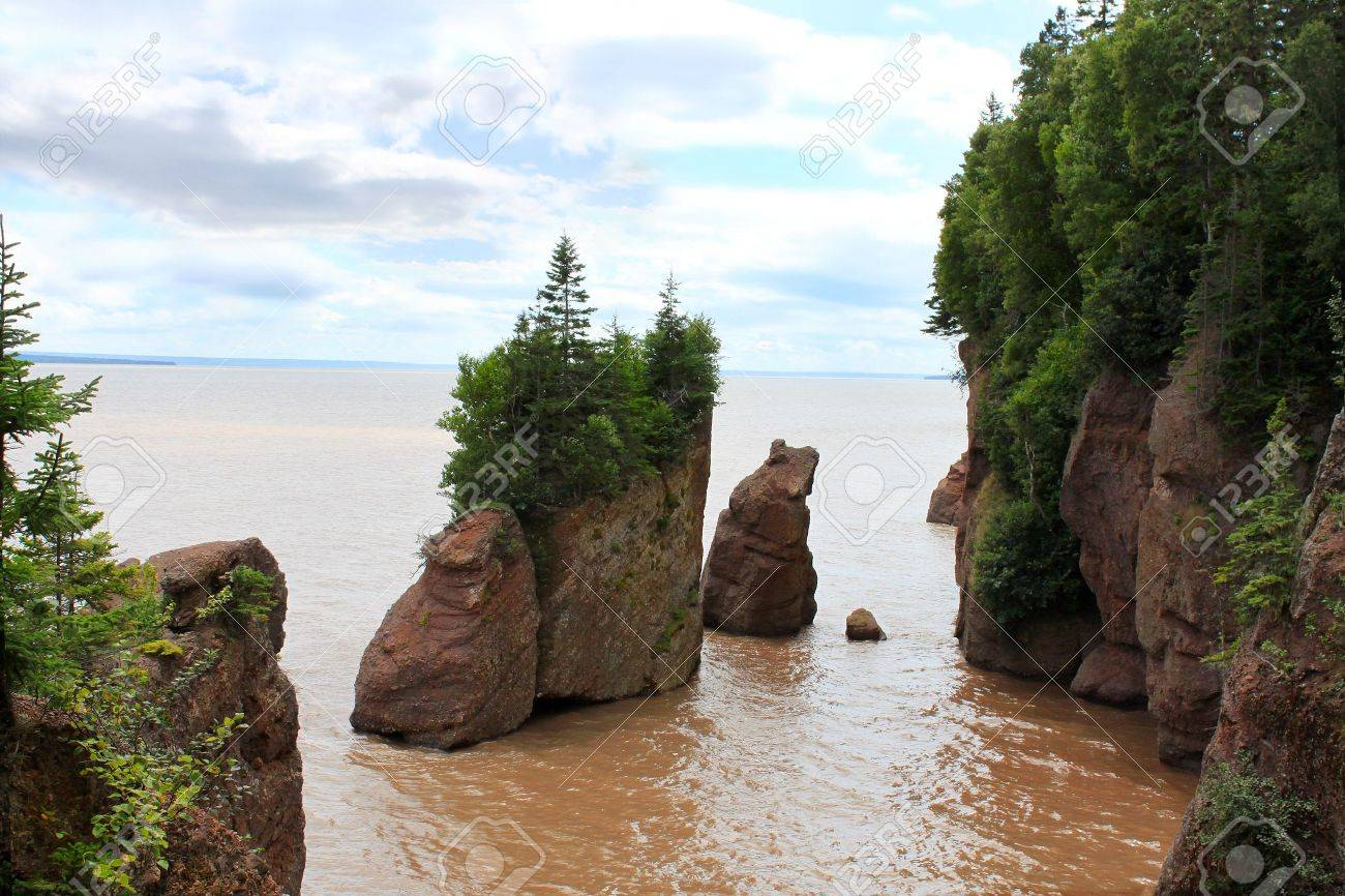 Muddy water with the high tide overlooking the Flowerpot rocks at Hopewell Rocks New Brunswick & Muddy Water With The High Tide Overlooking The Flowerpot Rocks ...