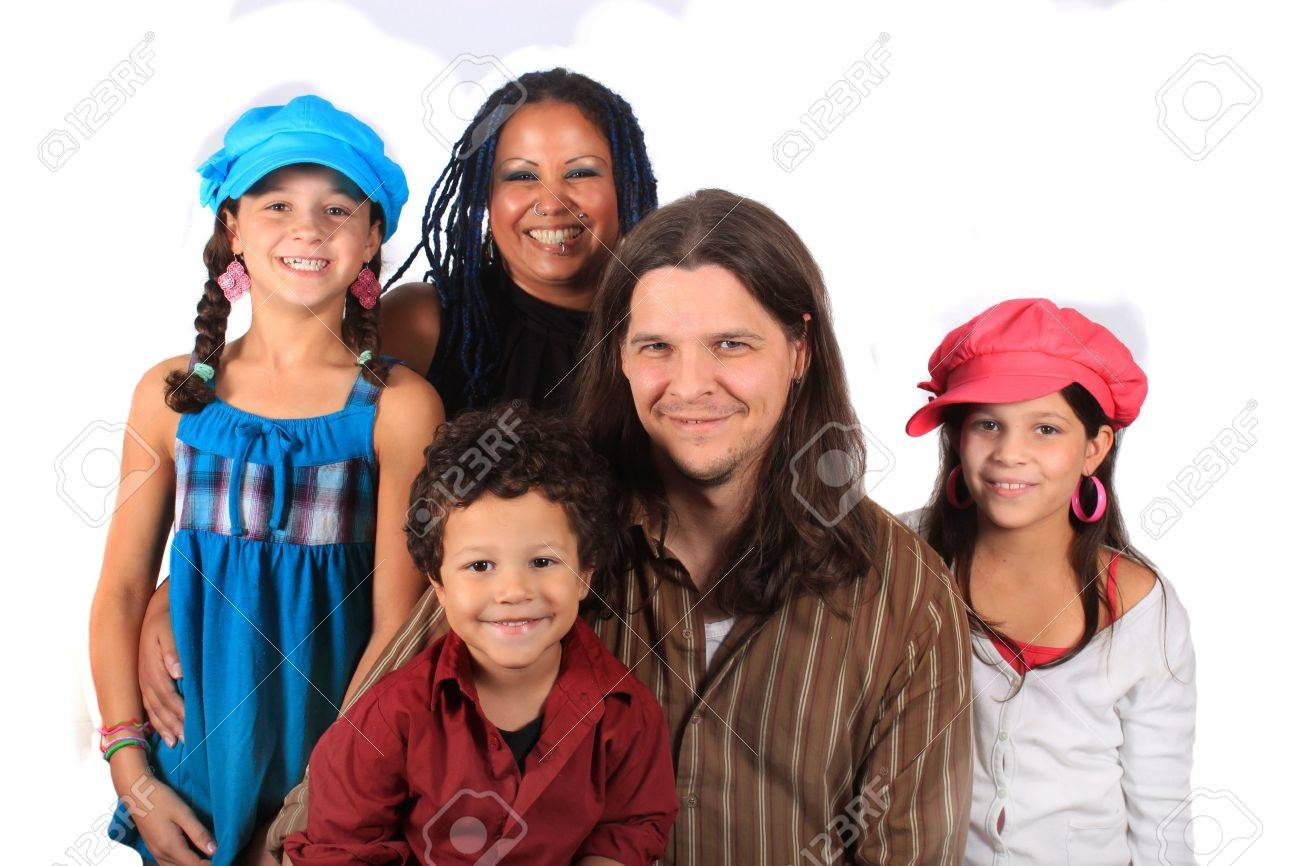 Young attractive ethnic family with parents, two girls, and one boy on a white background Stock Photo - 7937298