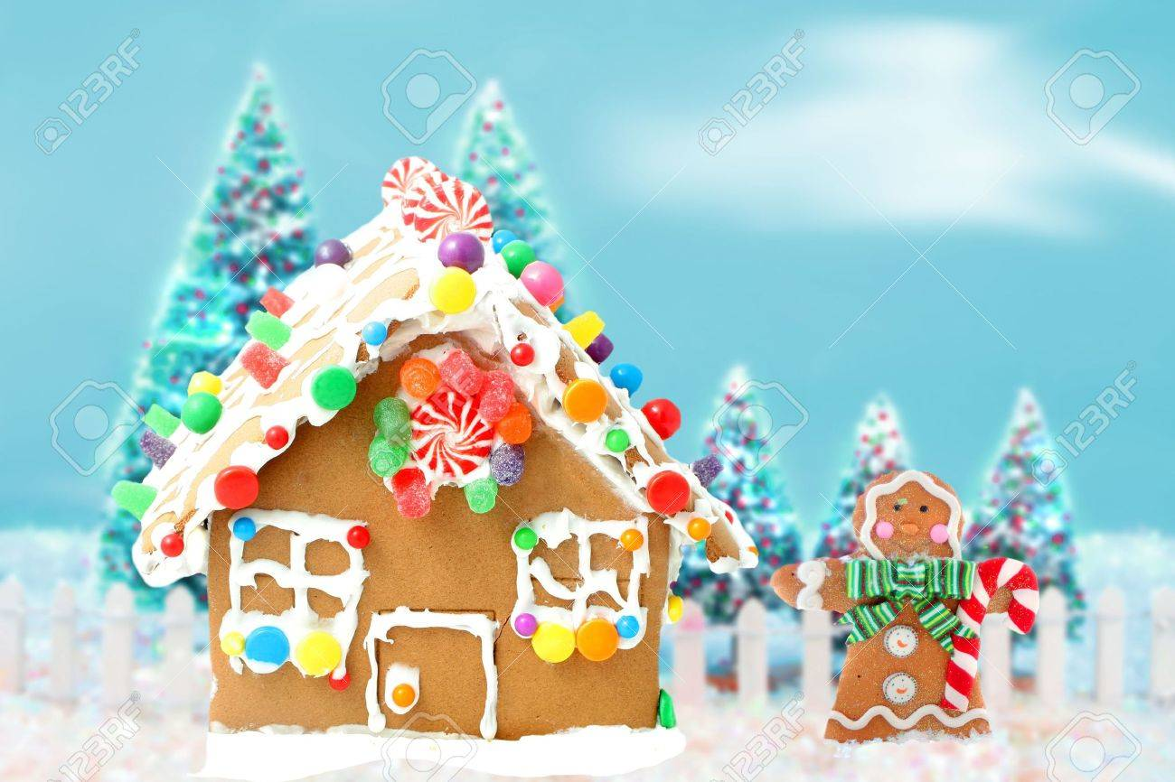 Gingerbread man cookie standing beside house  with different colored candy and gumdrops, a chrismas snow scene Stock Photo - 8190454