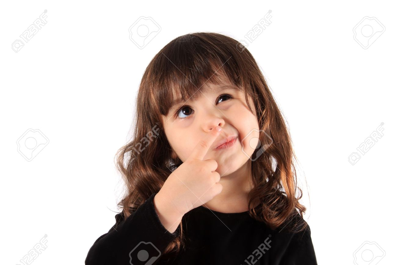 Little three year old brunette little girl holding her finger close to her nose with a thinking expression, hmm - 8244692