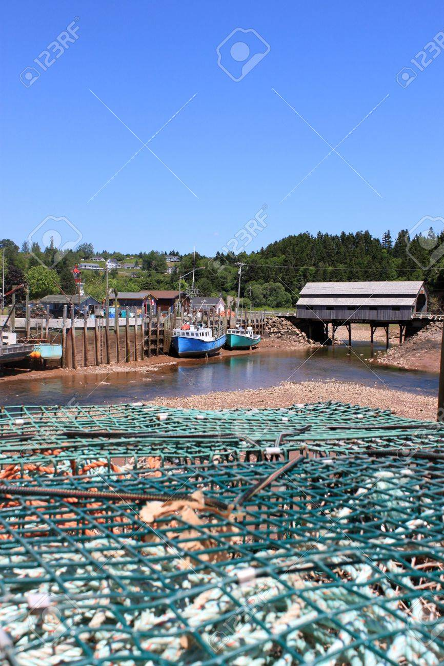 Fishing wharf in St  Martins, New Brunswick, Canada on low tide