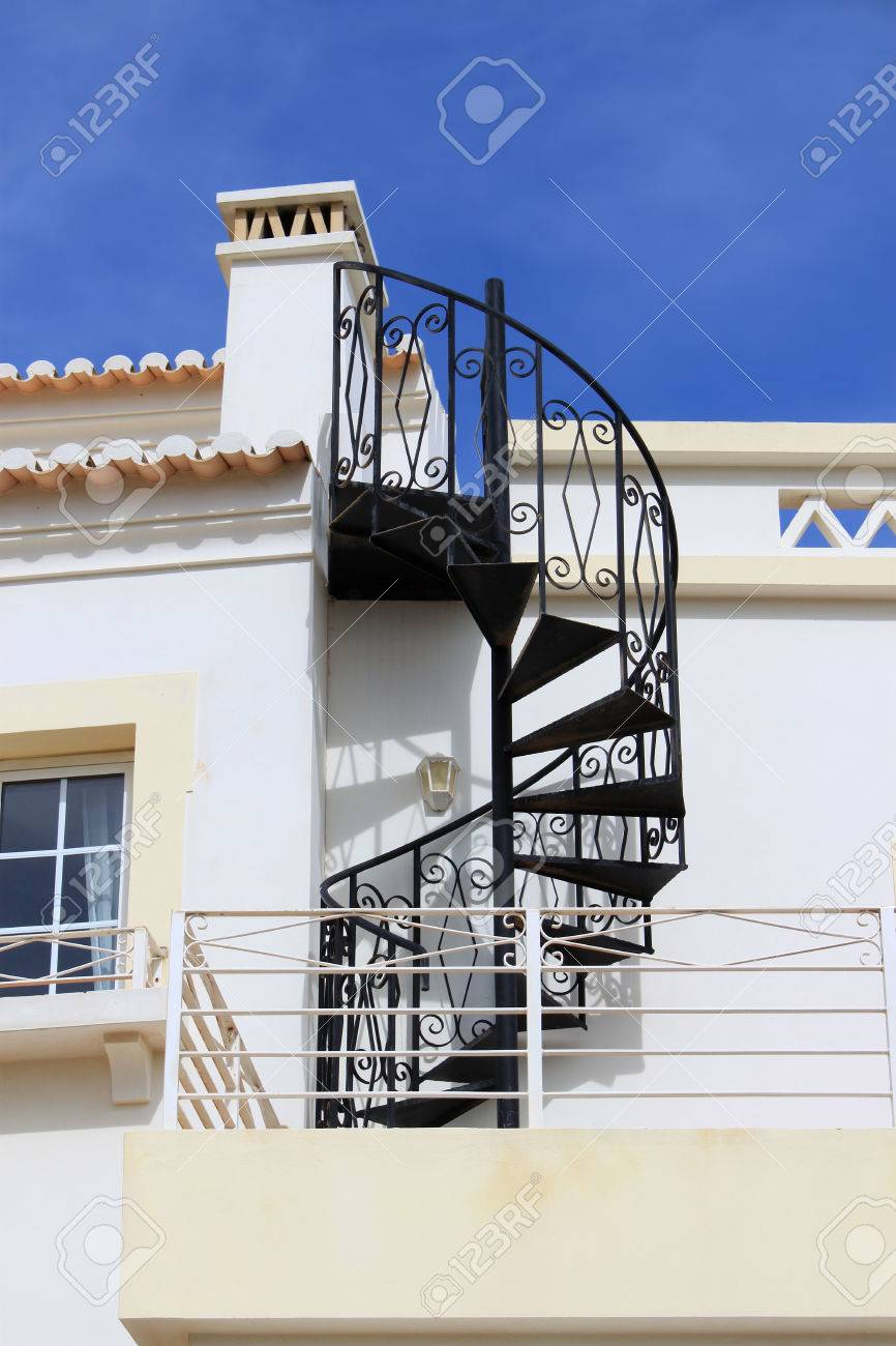 Abstract Twisty Iron Staircase Outside Of A House In Algarve