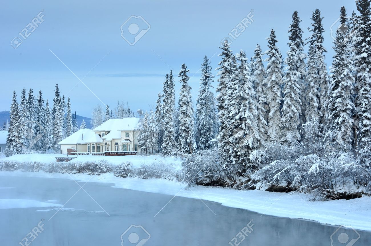 House on an Alaska River in Winter Stock Photo - 7676512