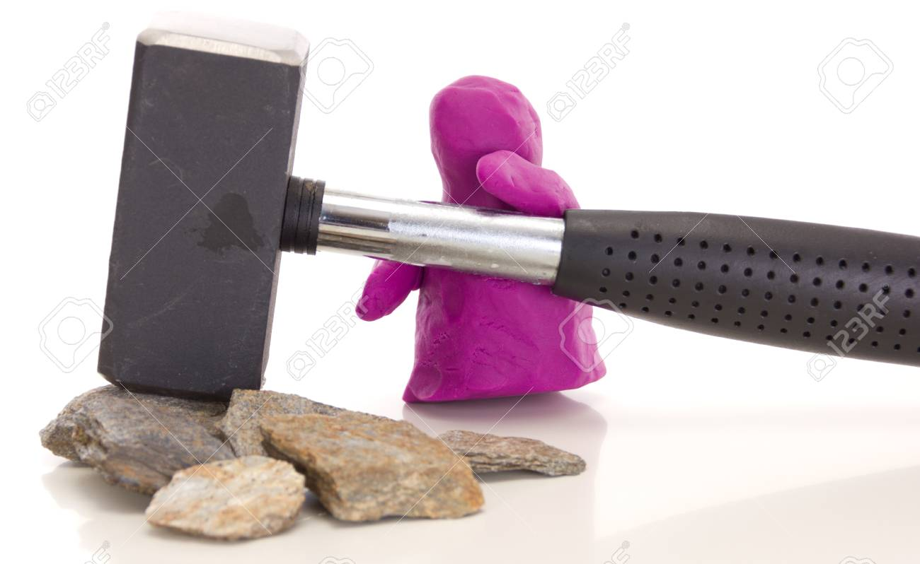 Modelling clay figure with a sledge Stock Photo - 14882964