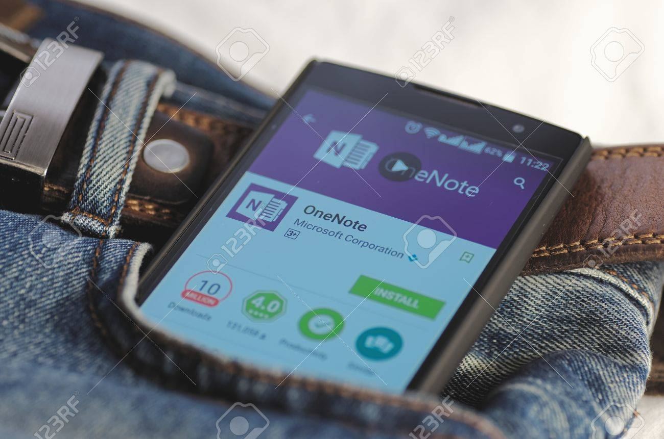 SARANSK, RUSSIA - April 3, 2016: Photo of Smartphone in a jeans pocket with Microsoft OneNote application in a Google Play Store on the screen. - 54990047