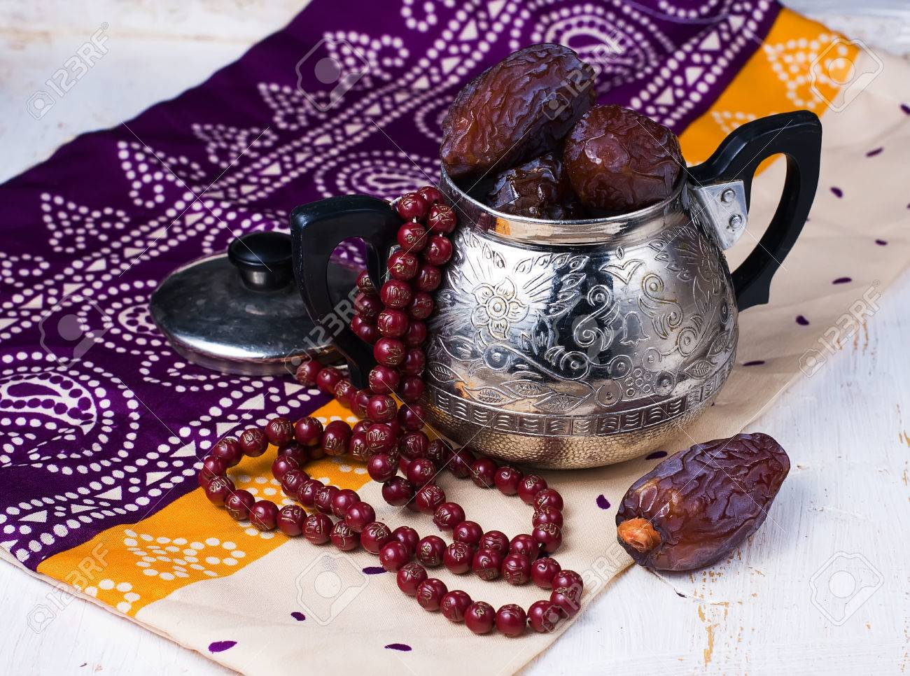 Dates fruit and rosary still life - 38683480