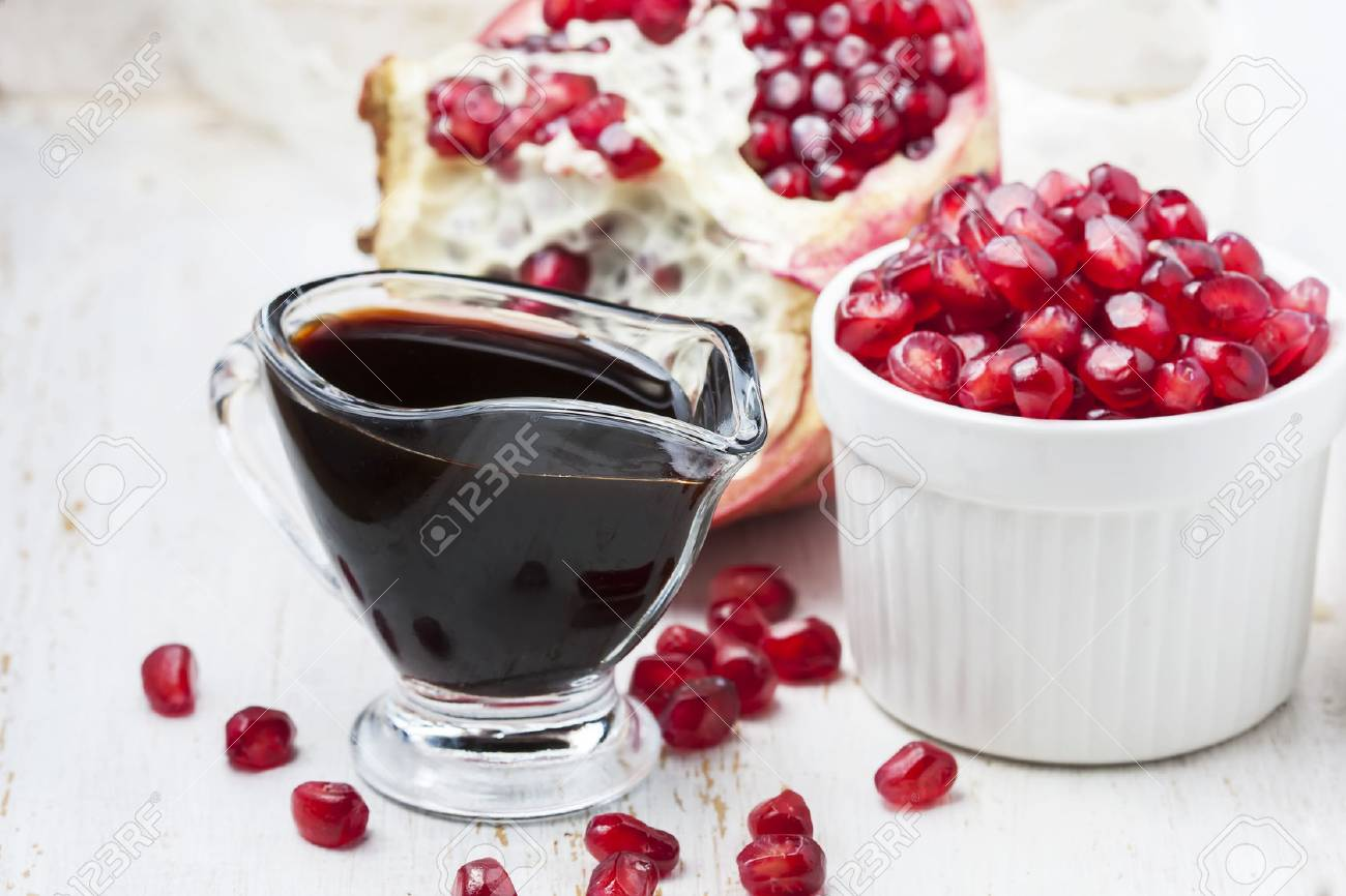 pomegranate sauce, on white background. Selective focus - 40368033