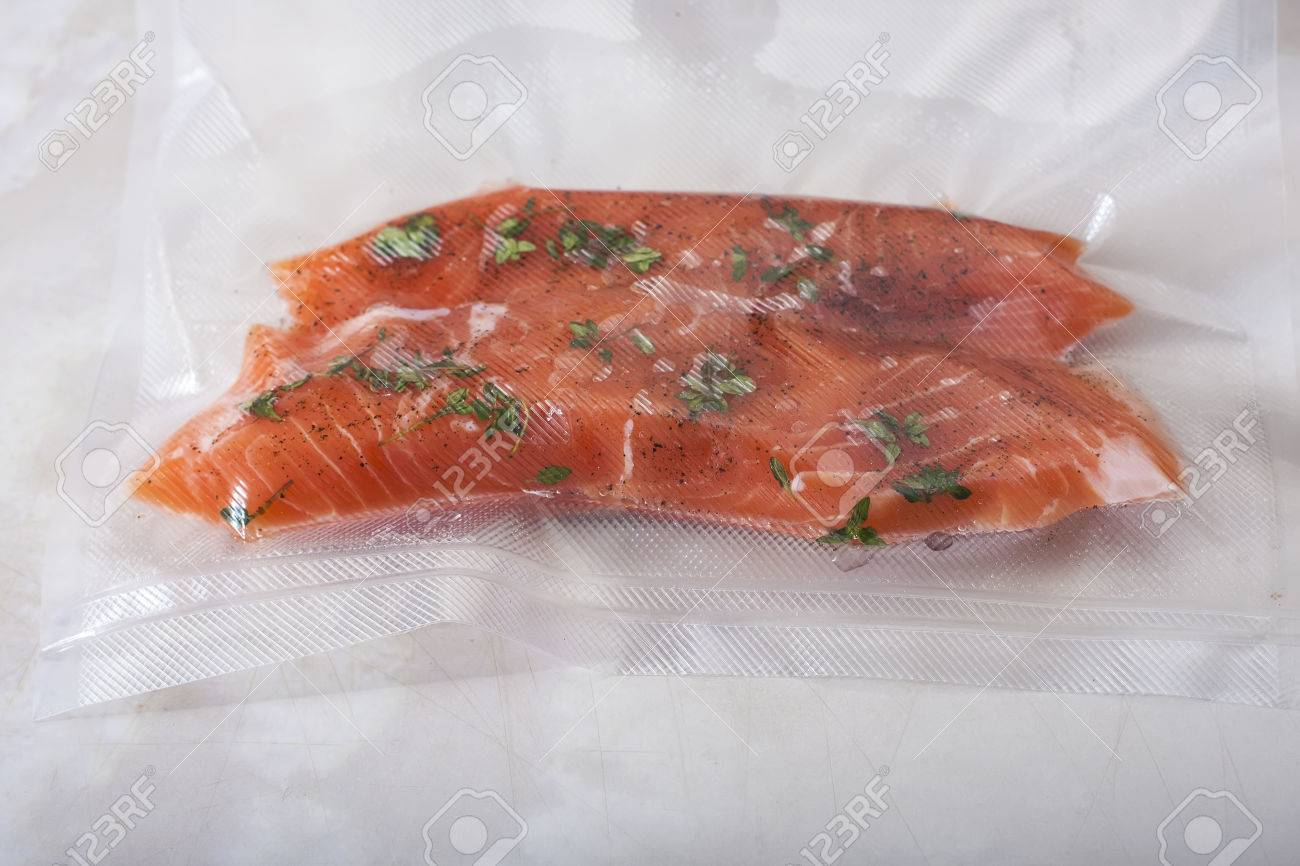 Salmon fillets in a vacuum package. Sous-vide, new technology cuisine - 51707055