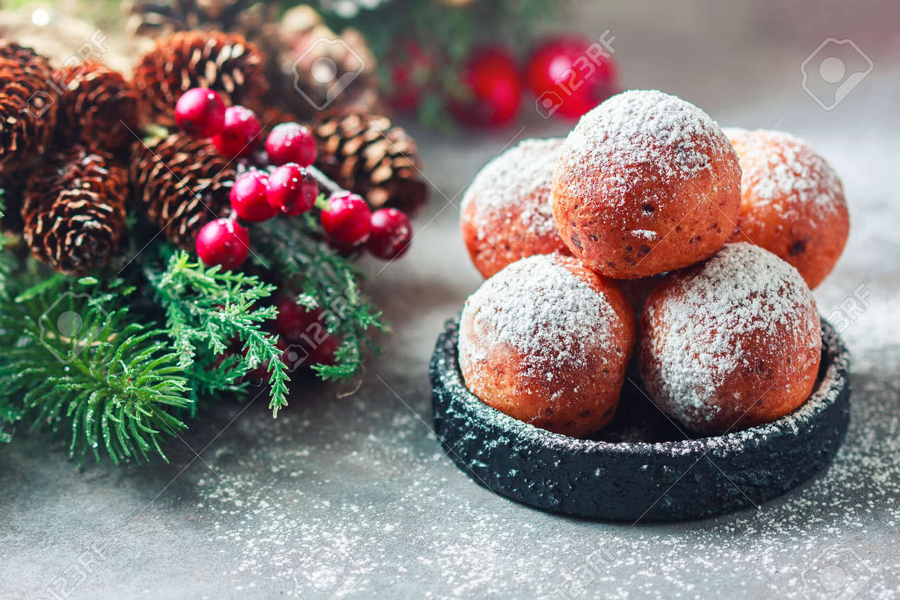 Sweet donuts from cottage cheese with powdered sugar. Christmas installation. Place for text. Selective focus - 89440173