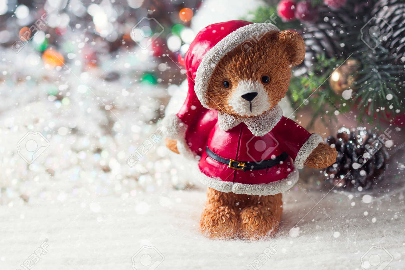 santa teddy bear christmas decorations on a white background selective focus stock photo - Bear Christmas Decorations