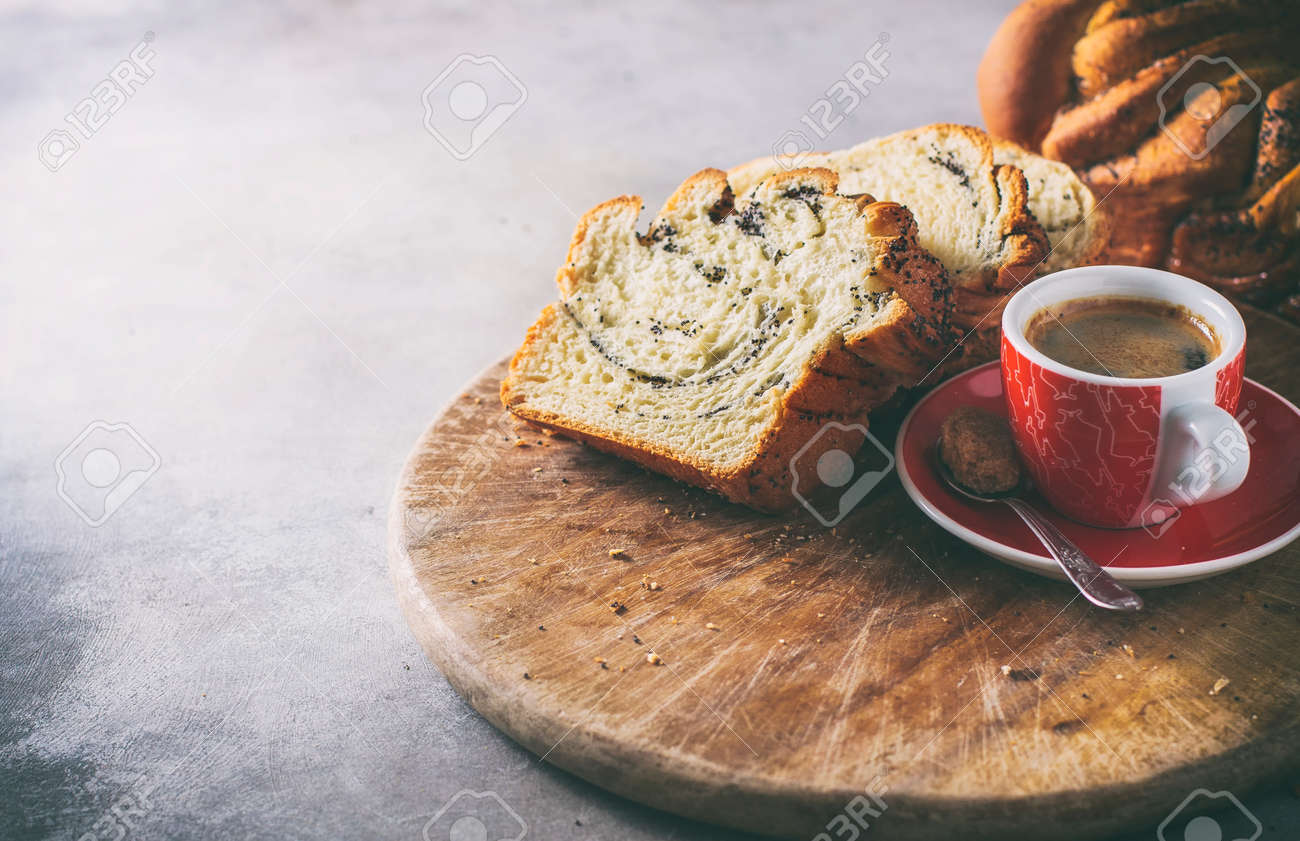 Homemade poppy seed braided bread, selective focus . Wreath. National pastries. Babka - 97152466