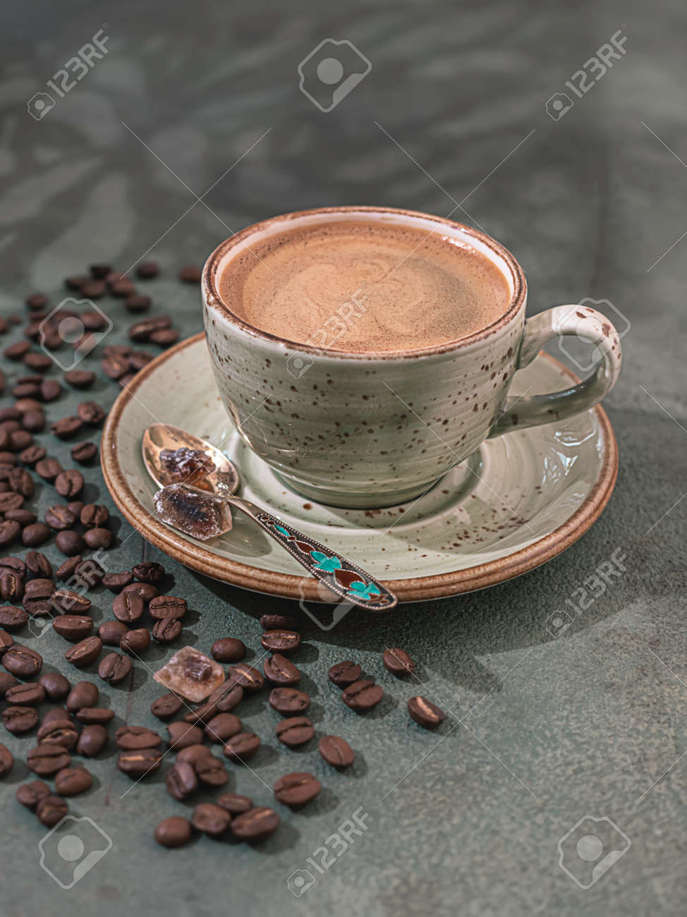 Fragrant strong coffee and coffee beans on a dark green concrete background. The concept of hot drinks. - 171765833