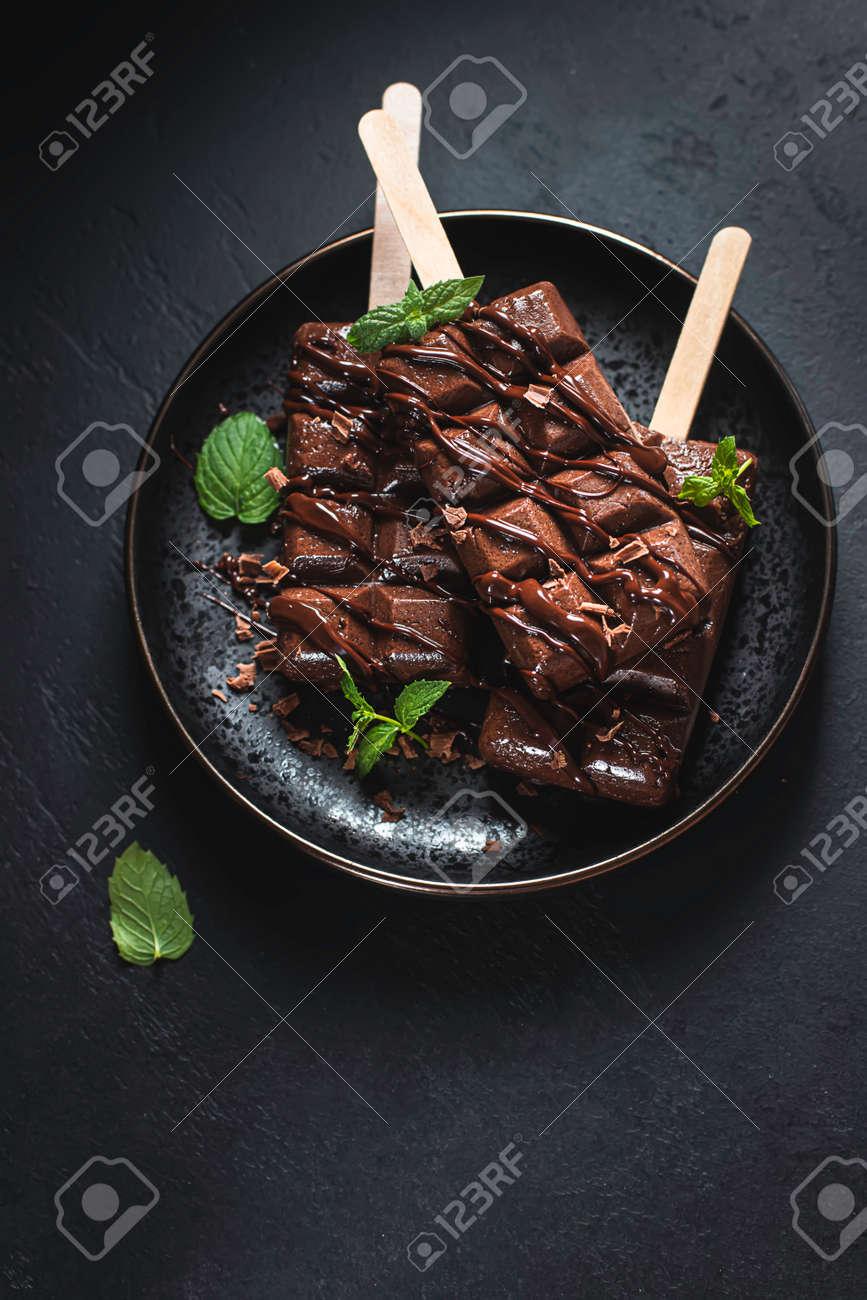 Homemade chocolate ice cream on dark background. Selective focus - 171890444