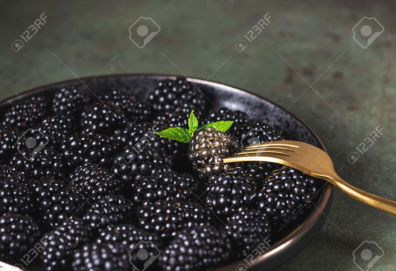 Fresh ripe blackberries as background, top view. Food concept. Blackberries decorated with edible gold powder. The concept of luxury is extraordinary. Top view. - 171890457