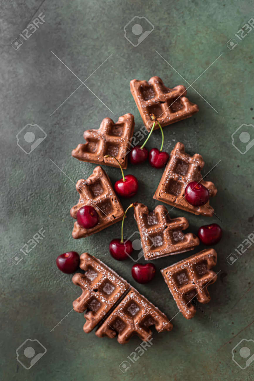 Homemade chocolate waffles with berries and chocolate ice cream. Delicious dessert or breakfast. Close-up - 171890464