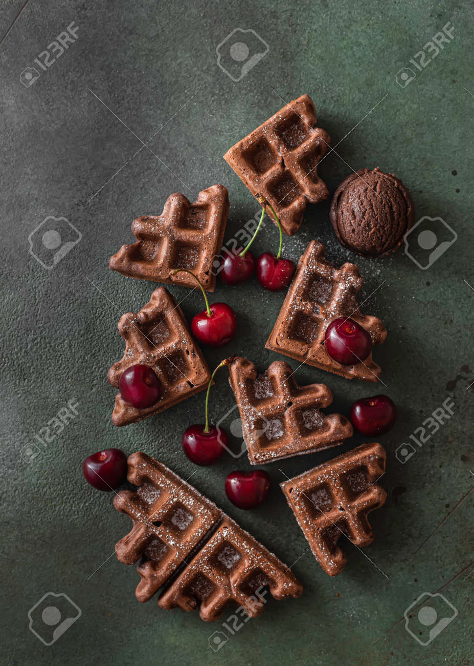 Homemade chocolate waffles with berries and chocolate ice cream. Delicious dessert or breakfast. Close-up - 171890470