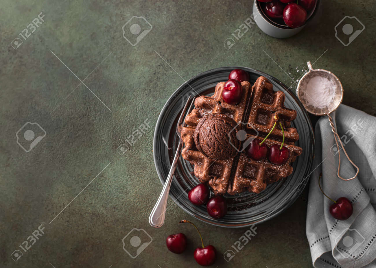 Homemade chocolate waffles with berries and chocolate ice cream. Delicious dessert or breakfast. Close-up - 171890474