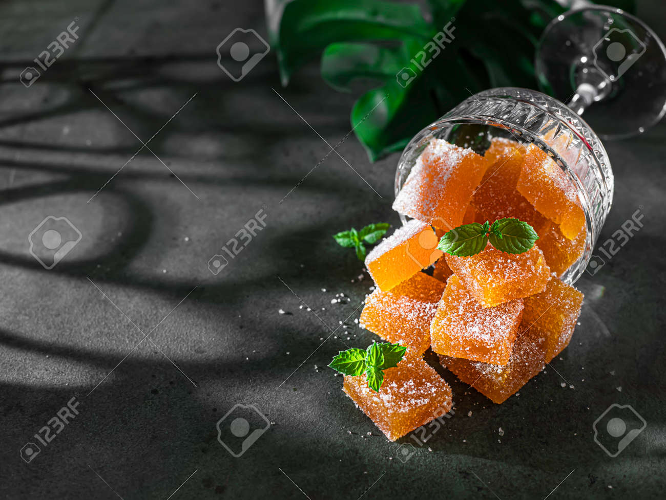 Homemade from mango and passionfruit jelly candies in sugar with mint. Homemade marmalade candy. Selective focus - 172307973