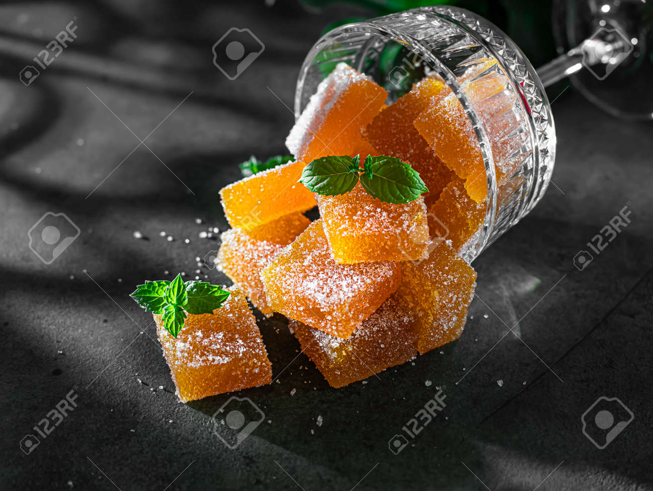 Homemade from mango and passionfruit jelly candies in sugar with mint. Homemade marmalade candy. Selective focus - 172308288