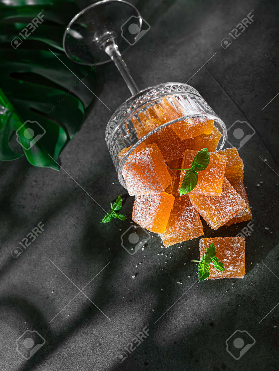 Homemade from mango and passionfruit jelly candies in sugar with mint. Homemade marmalade candy. Selective focus - 172320709