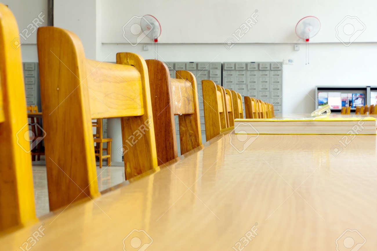 Library shelves, a large number of books. Stock Photo - 13412192
