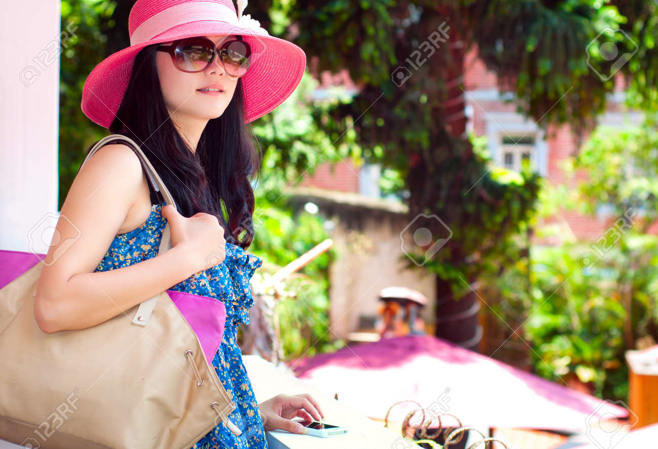 Asian girl with Dayan Mao and sunglasses Stock Photo - 14597961