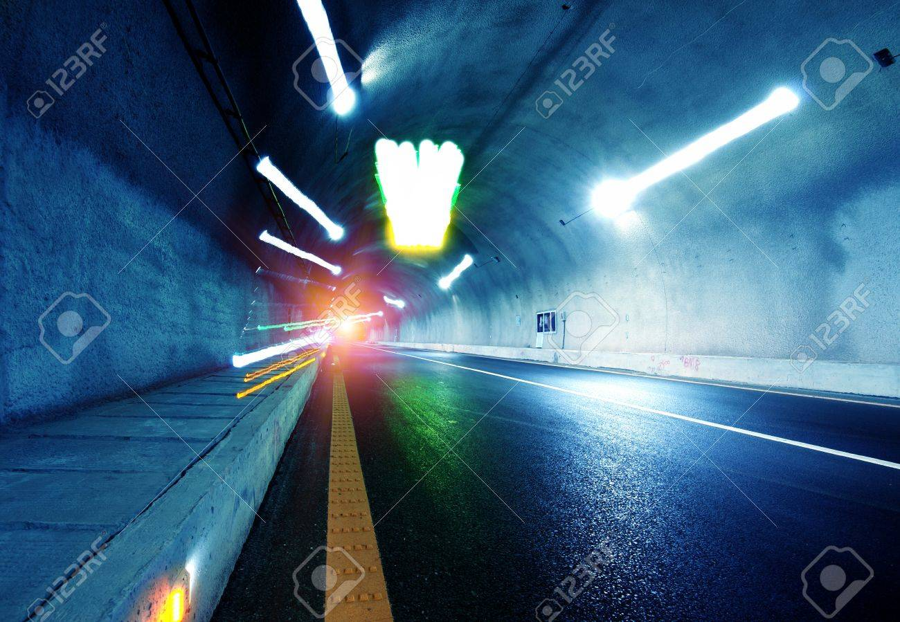 Abstract speed motion in urban highway road tunnel, blurred motion toward the central. Shot from a slow moving car Stock Photo - 15912169
