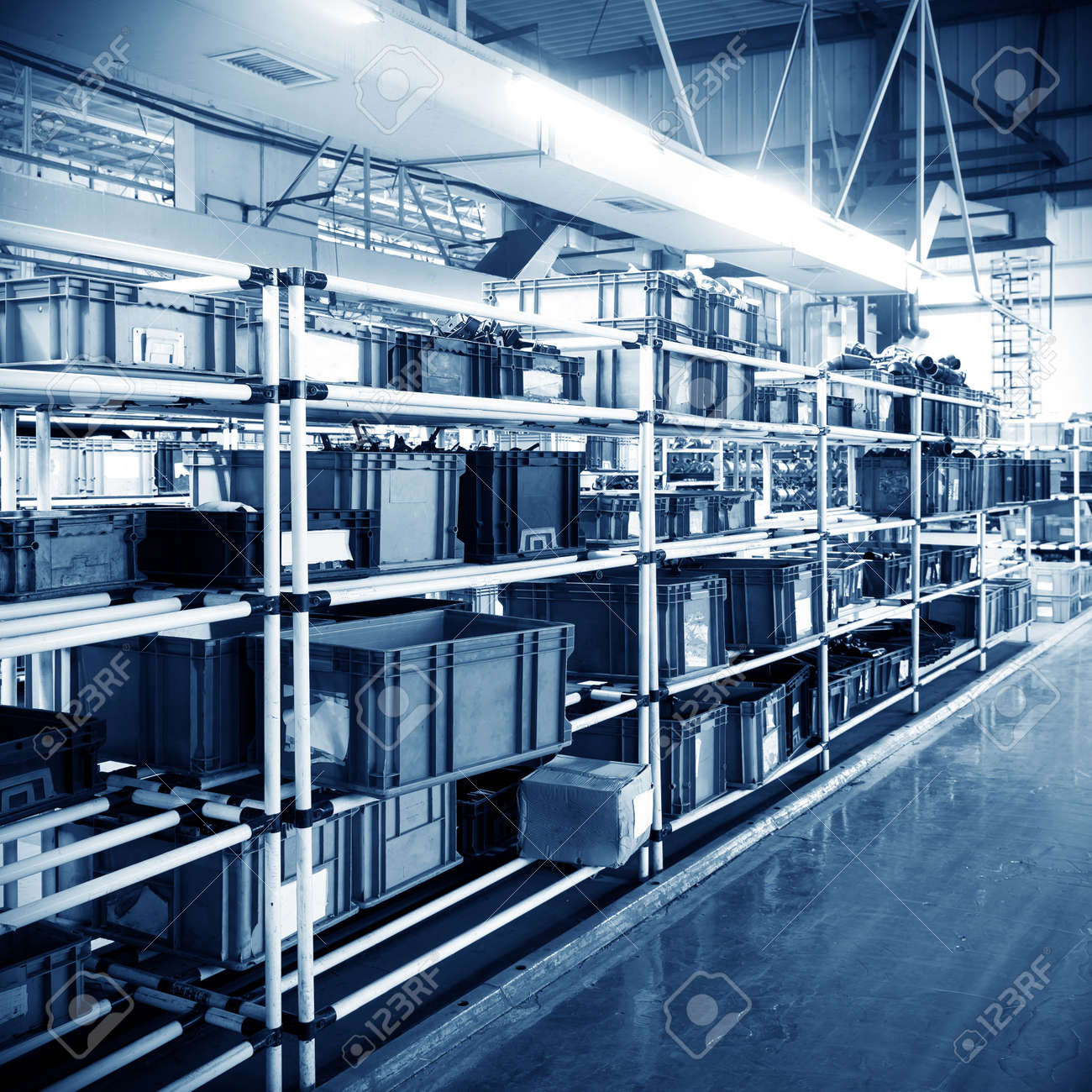 Factory warehouse shelves stocked with plastic containers. - 31890779