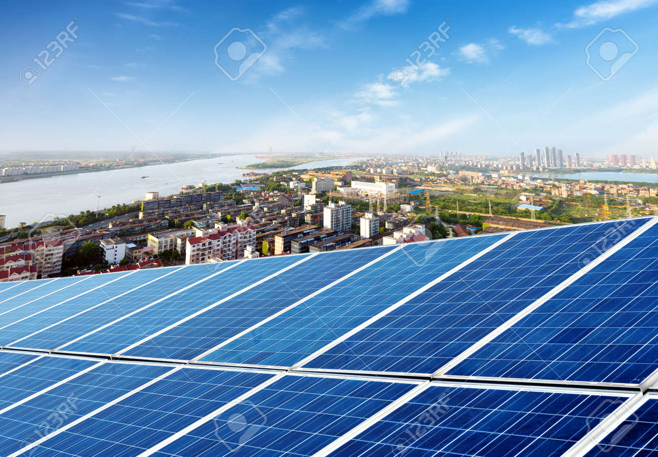 Aerial view of the city and the tower on top of the solar panel - 36092922