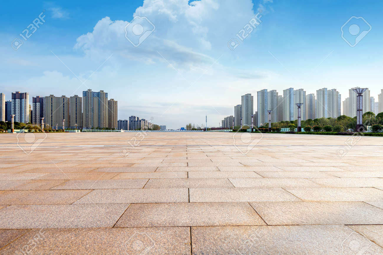 Empty floor and modern building with sunbeam - 46407797