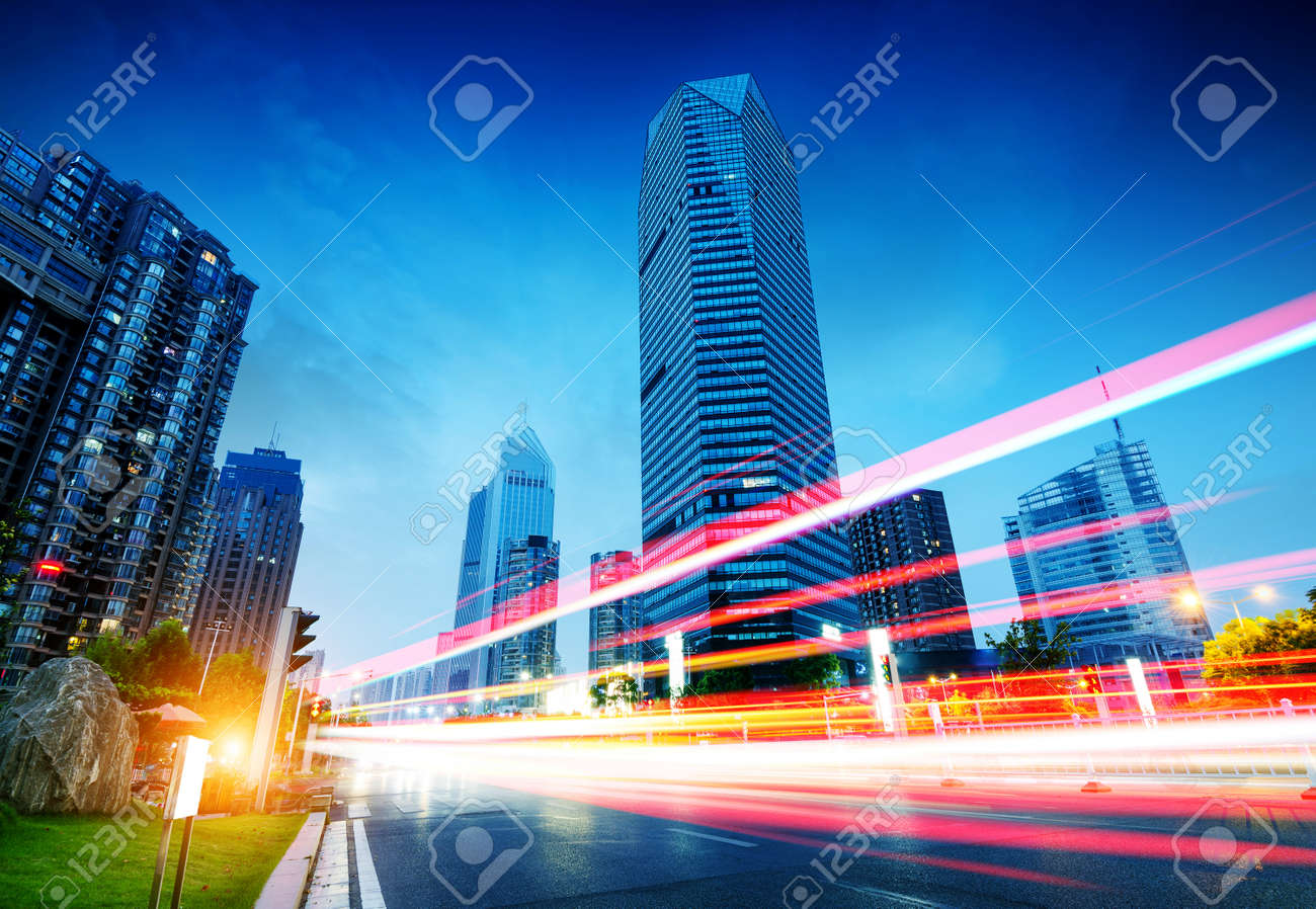 The light trails on the modern building background in shanghai china. - 47624005