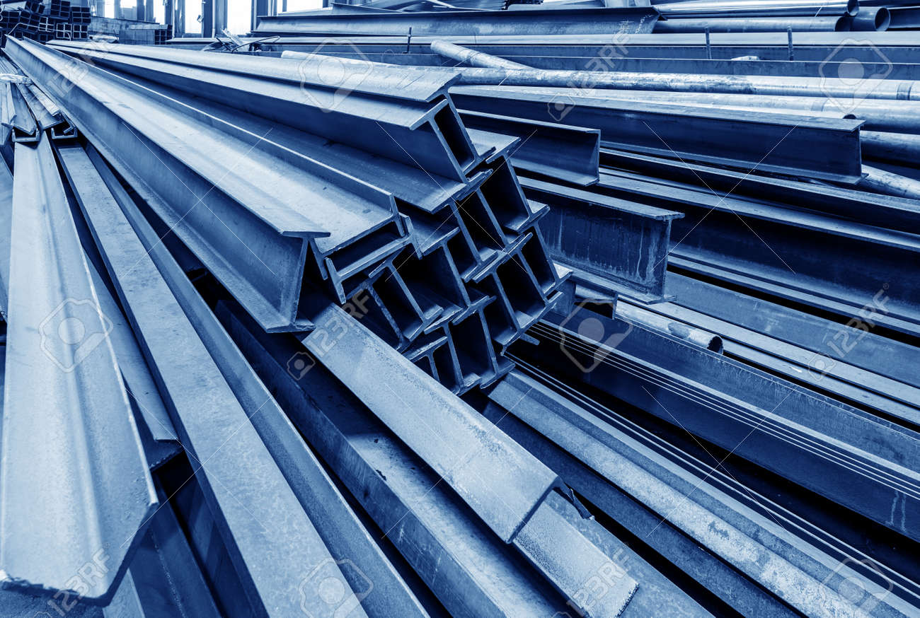 Steel factory floor, stacked with a lot of steel - 54467838