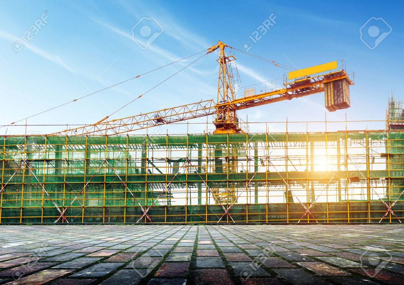 Construction site scaffolding and cranes Standard-Bild - 60408179