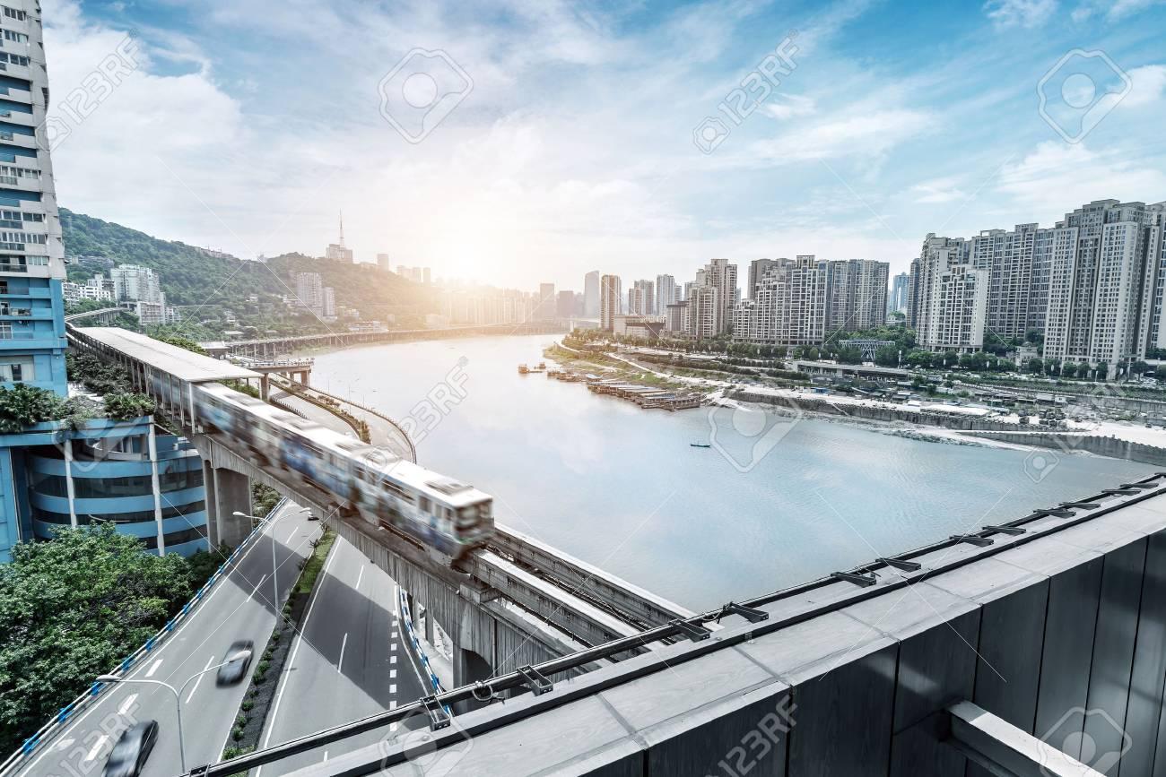 light rail moving on railway in chongqing - 62103336
