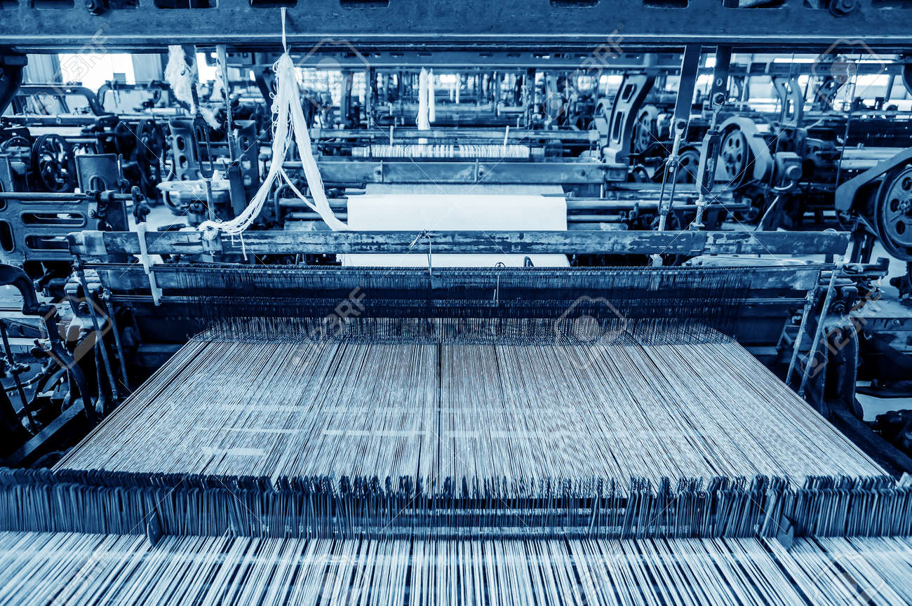 Thread from weaving machine, Abstract background - selective focus. - 62599262