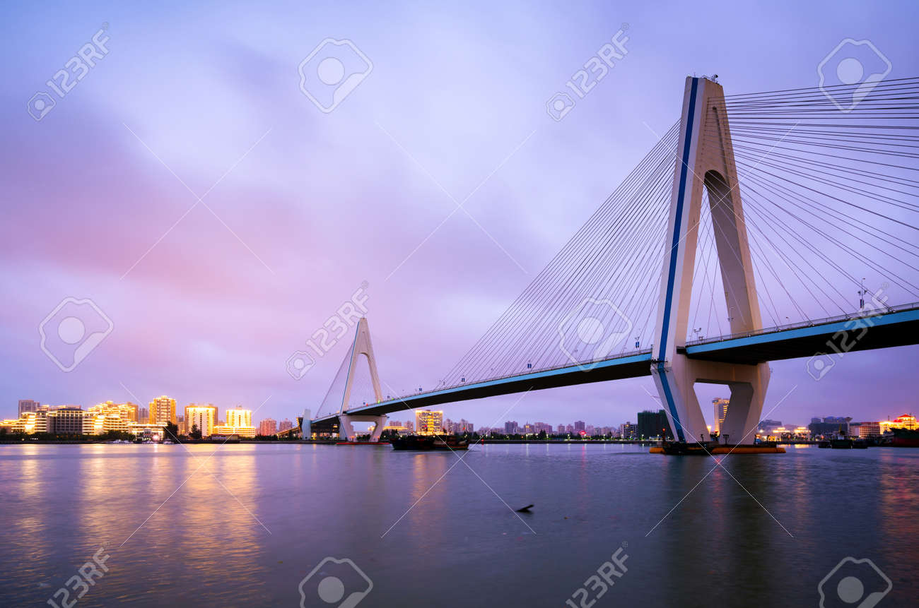 City skyline and sea bridge at night, Haikou, Hainan, China - 101271253
