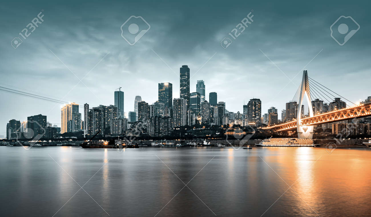 cityscape and skyline of downtown near water of chongqing at night - 122771222