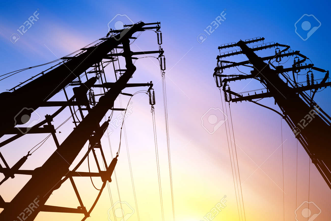 High voltage electricity poles and dusk sky - 139651300