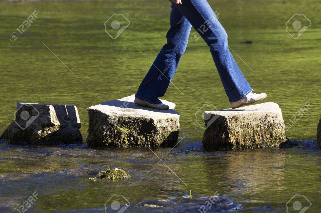 crossing three stepping stones in a river Stock Photo - 227965