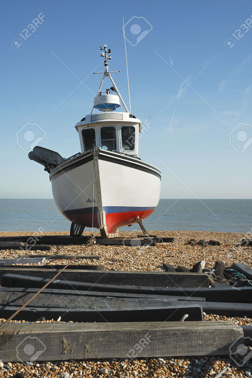 A Fishing Boat With The Wire Cable Used To Pull It Onto The Beach ...