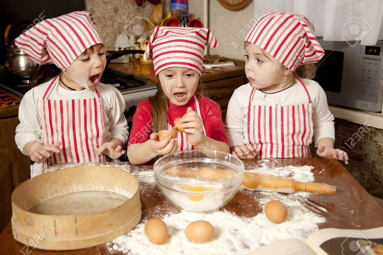 Three Little Chefs Enjoying In The Kitchen Making Big Mess Little Girls  Making Bread In The