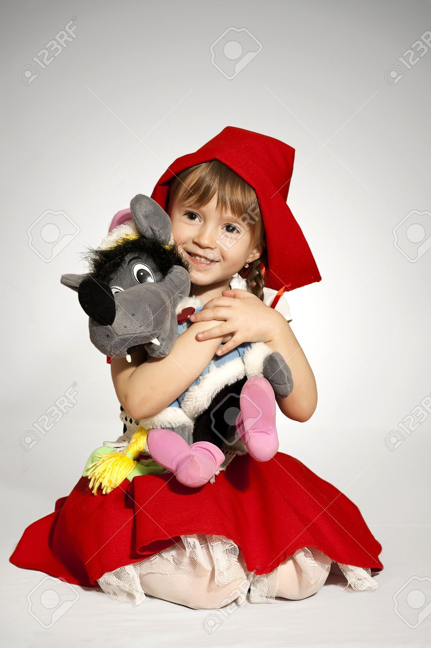A girl with a toy wolf wearing Little Red Riding Hood costume Stock Photo - 12973053