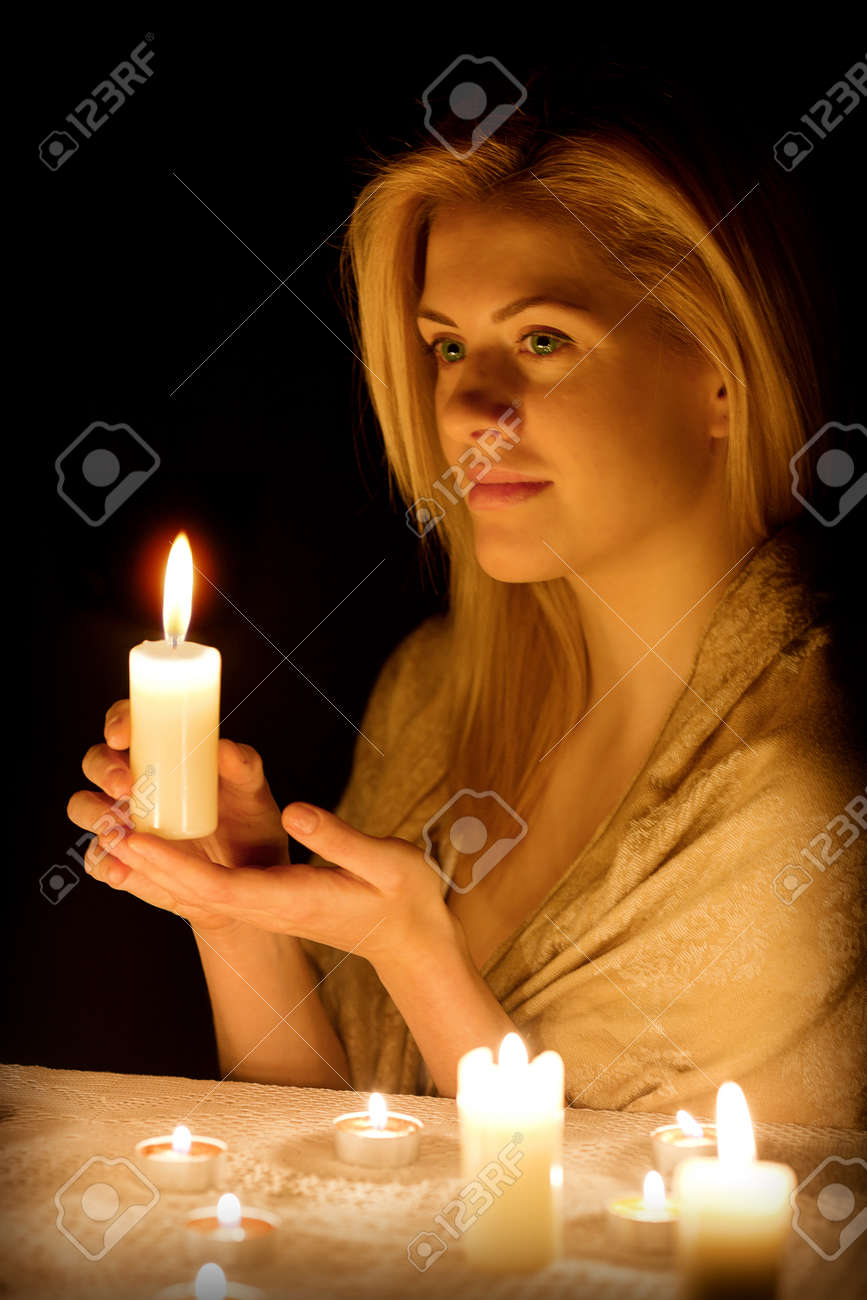 Beautiful girl with a candle in the dark Stock Photo - 14748895