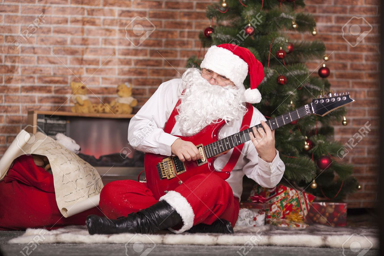 Santa Claus Plays The Guitar On The Background Of The Christmas ...