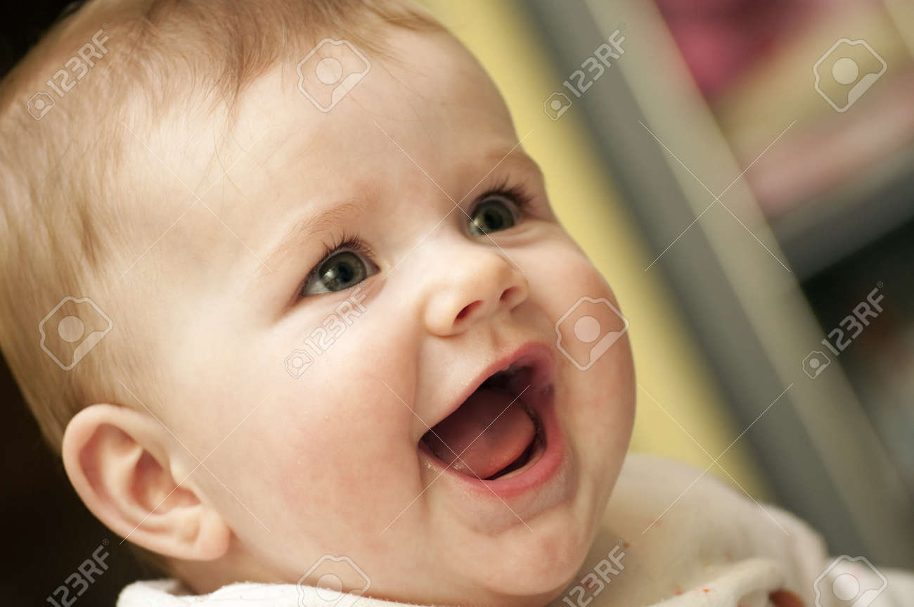 Baby Girl is just having fun and laughing Stock Photo - 15302189