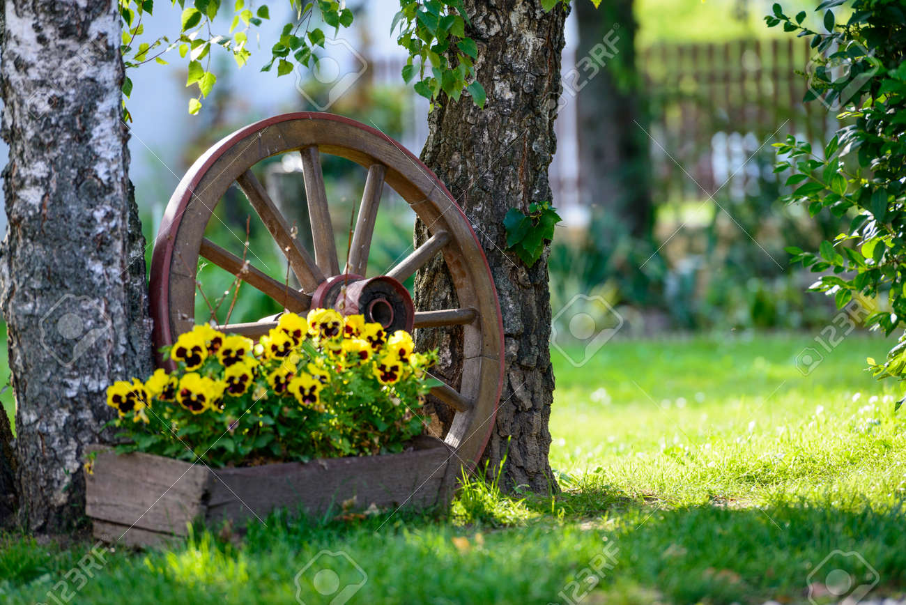 Old Wooden Cart Wheel Decoration For The Garden Stock Photo, Picture ...