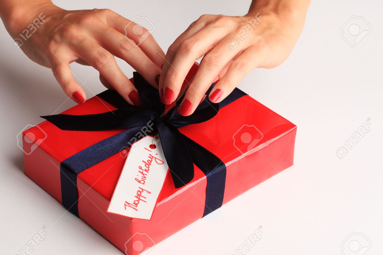 Woman Wrapping A Happy Birthday Gift Box Stock Photo, Picture And ...
