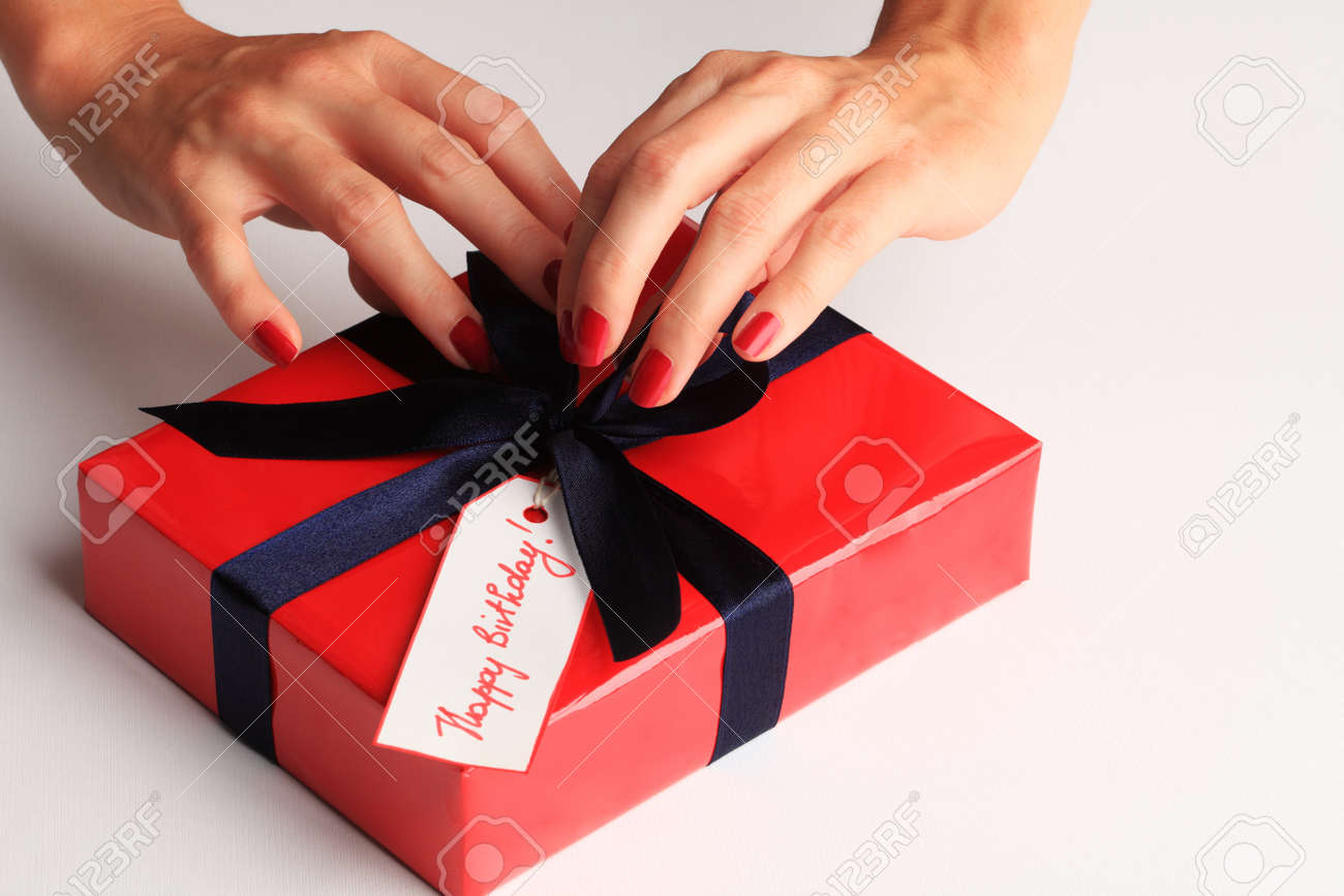 Woman wrapping a happy birthday gift box stock photo picture and stock photo woman wrapping a happy birthday gift box negle Image collections
