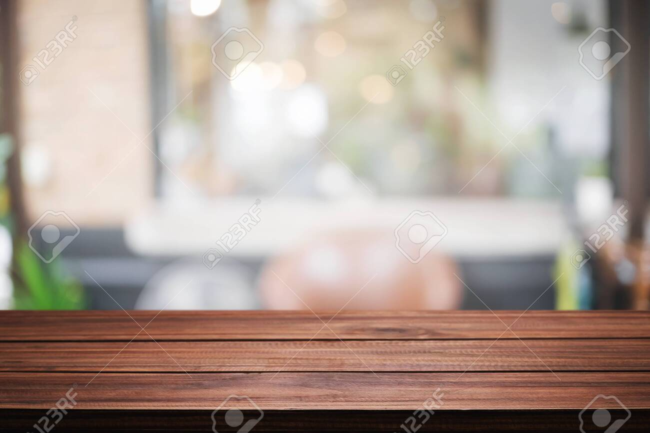 Empty wooden desk space and blurry background of restaurant vintage tone for product display montage - 131789038