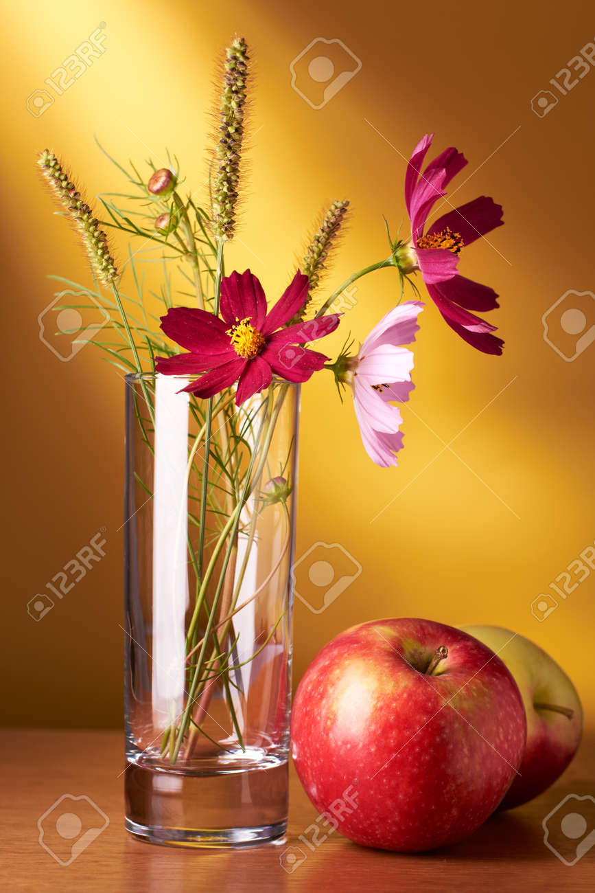 Still life with flowers and apples on yellow background - 11136246